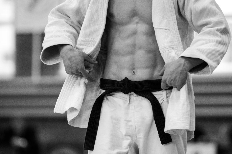 Judo,Athlete,In,White,Kimono,And,Black,Belt,Black,And